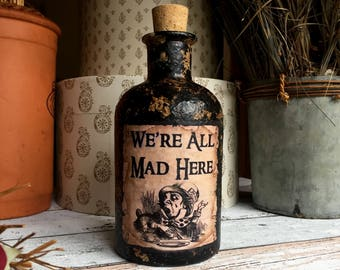 Steampunk Alice in Wonderland. We're All Mad Here. Alice in Wonderland Gift. Mad Here Bottle. Mad Hatters. Alice in Wonderland Decor. Bottle