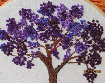 Embroidered  tree in shades of purple. Finiahed in an 8in rounfhoop.