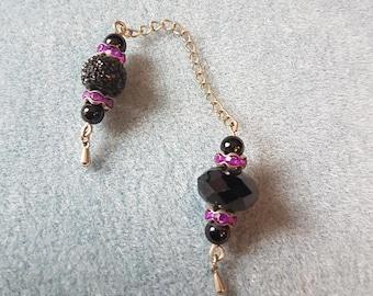 Pendulum with obsidian and cherry quartz gemstone