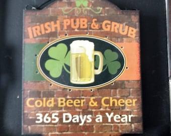 Lighted Irish pub and grub beer sign