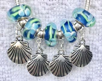 """A Murano beads with beautiful tropical flower design and silver sea shells.""""Tropical Flowers and Shells Bracelet """""""