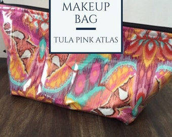 Zippered makeup bag in a Tula Pink Moth fabric with clear vinyl top layer