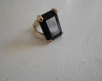 Vintage solitaire black ring.  Silver band.  Size 7 and a half.