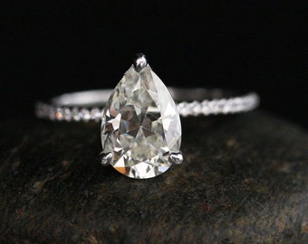 9x6mm Pear Brilliant Moissanite in 14k White Gold with Diamond Half Eterntiy Band