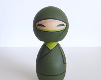 7E Shinobi. Ninja kokeshi doll.