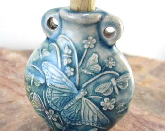 Peruvian Ceramic Raku Butterfly Bottle