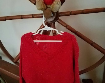 Little girl's red tweed sweater