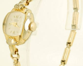 Milber vintage ladies' wrist watch, 17 Jewels, oval yellow gold plated & stainless steel case with a high-domed glass crystal