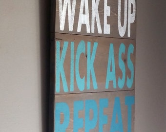 Inspirational saying reclaimed wood sign.. Wake up, kick ass, repeat