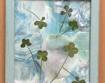 Swirling in Blue-Four-leaf clover pictures featuring 7 authentic, found in nature, 4-leaf clovers. Each framed picture is one of a kind.