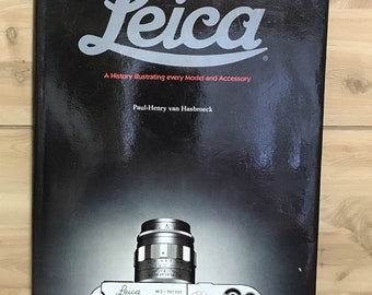 First Edition LEICA Camera Book, hardcover reference with photos, every Leica ever made, large hardcover book