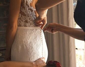 300 crochet hooks to button wedding dress