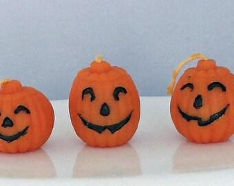 Three Vintage Halloween Jack o Lantern Pumpkin Candles