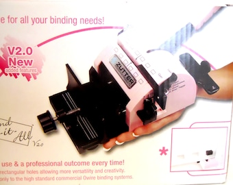 Zutter Bind-It-All Binding System Version 2 in pink perfect for crafting scrapbooking planners art journaling calendars and holiday projects