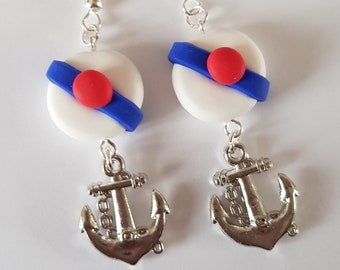 holiday theme earring has white sailor Hat pompom bachi sea