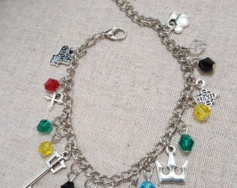 """Kingdom Hearts inspired 7"""" charm bracelet.  Includes seven KH charms and twelve multi colored glass beads."""
