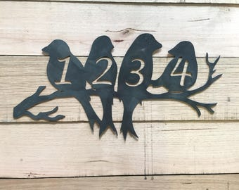 Birds on a branch House number sign