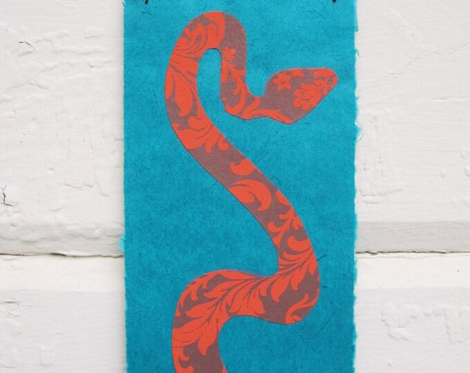 Orange Floral Snake on Turquoise