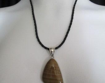 Pretty handcrafted silver metal wrapped polished yellow banded Agate pendant necklace on braided cord