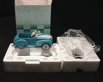 Vintage Kiddie Car Classics a 1941 Oldsmobile in it's Original Packaging
