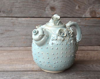 Alice in Wonderland Teapot with dots   Stoneware teapot with roses in light blue granitic glaze