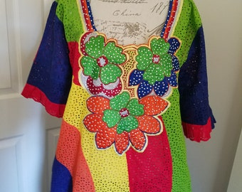 A long senegalese designed African lace 58 inches long. This is a show stopper with bright colors and a relaxed fit