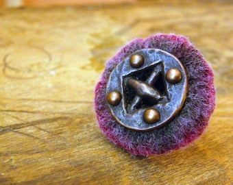 Handmade ring made of yarn with large copper button