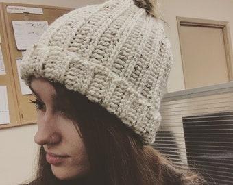 Crochet hat with fur pompom