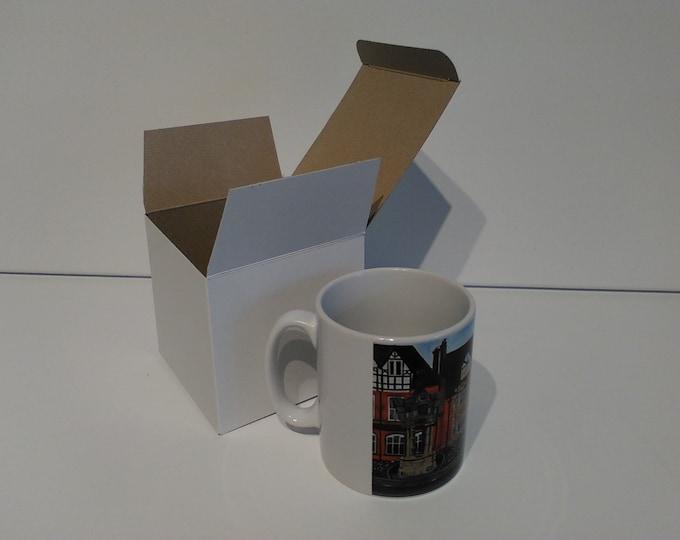 The Wheatsheaf ceramic drinking mug featuring artwork by Christian Turner