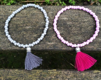 Handmade beaded bracelet with mini tassel