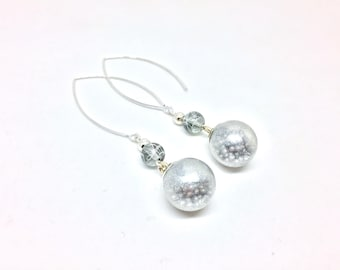 Glass globes glitter with silver beads and pearls