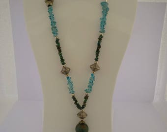 Blue asymmetrical necklace and metal