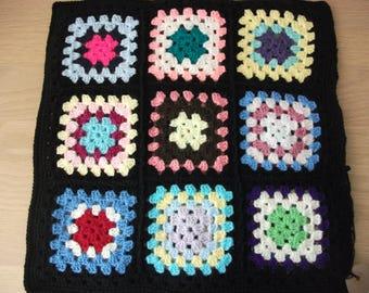 Hand crochet , granny squares cushion cover, button fastening, retro, conservatory, garden room, caravan, multicoloured, edged in black