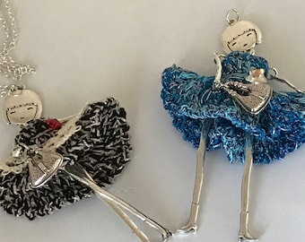 Metal doll pendant with crochet dress