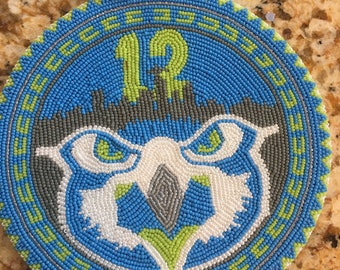 Hand made Native American beadwork medallion Seattle Seahawks themed. Medallion is 5in wide