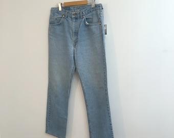 Vintage FADED LEVIS JEANS / size 30-32