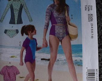 Mccalls M7417 Misses/Girls Swimwear (uncut) in sizes Misses (S-M-L-XL) Girls (3-4, 5-6, 7-8)