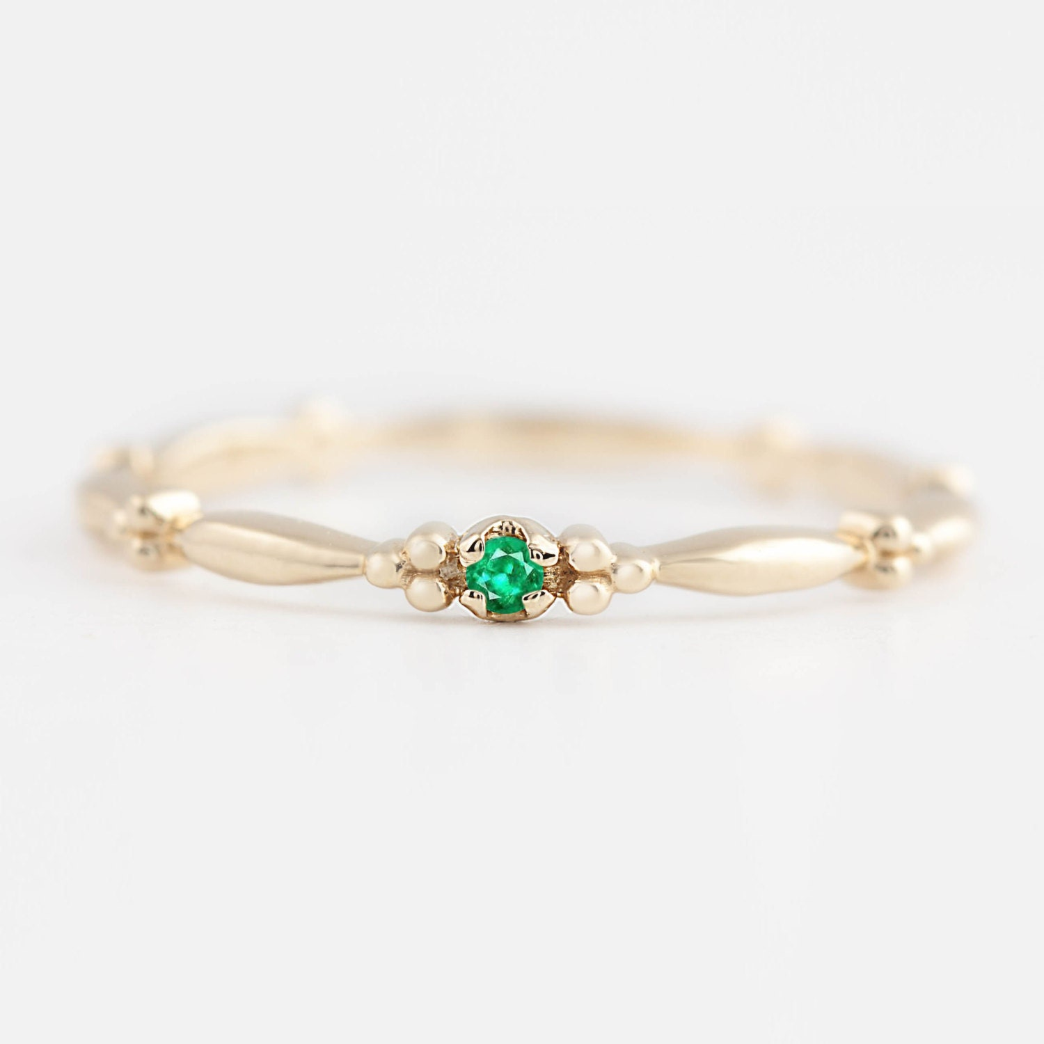 gold ring white diamond emerald and celtic