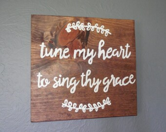 Tune my heart to sing thy gracewood sign