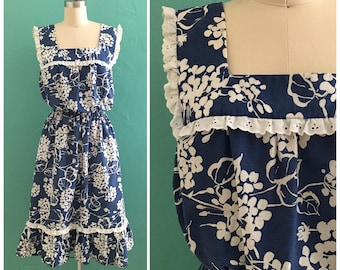70's blue floral print dress  with eyelet trim