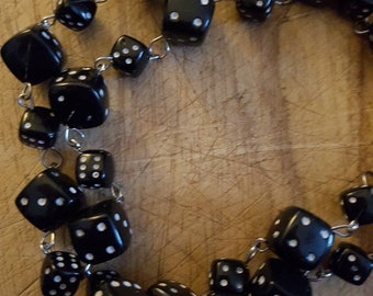 90s dice necklace.