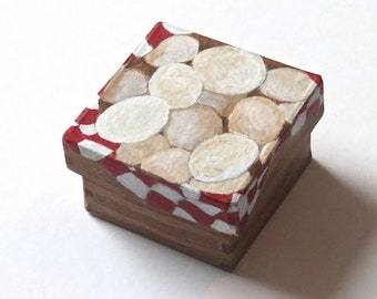 A small handpainted paper mache box 'Basket of Eggs'