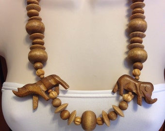 Vintage Wood Elephant and Rhinoceros Hand Carved Necklace 27.75 Inches Long Previously Thirty Dollars ON SALE