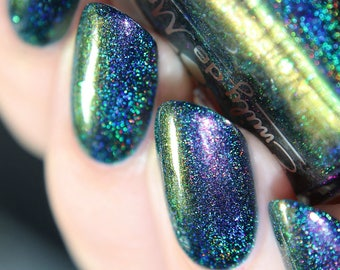 "Nail polish - ""Downward Spiral"" A navy blue holo with pink / green / gold shifting shimmer and iridescent flakes"