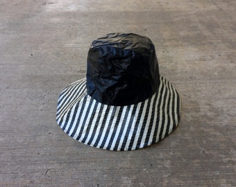 Sleek Stripe -- Black and white plastic hat with a wide brim -- Lady Chesterfield
