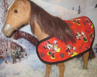 Adorable Horse Blanket for your Doll's Pony. It is reversible and very warm -- keeping your pony warm at night. It is ready to ship.