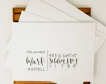 Hand written calligraphy envelope hand lettere blush