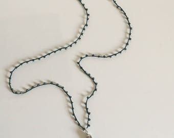 Crochet necklace with nappy and dark green briolette