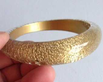 Bangle - Chunky glittery gold bangle lucite plastic