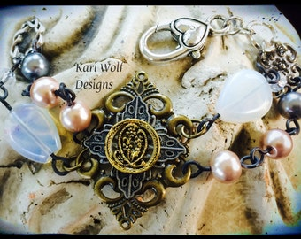 Antique, Button, Bracelet, Ornate, filigree, Pearls, Swarovski Crystal beads, & moonstone beads Created By: Kari Wolf Designs
